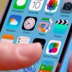 Hand-holding-iPhone-5C-using-iOS-7