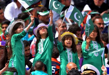 Young Pakistani children wave national flags as they watch the Pakistan Day military parade in Islamabad on March 23, 2016. Pakistan National Day commemorates the passing of the Lahore Resolution, when a separate nation for the Muslims of The British Indian Empire was demanded on March 23, 1940. / AFP PHOTO / AAMIR QURESHI