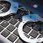 handcuffs-computer-cyber-keyboard-arrested