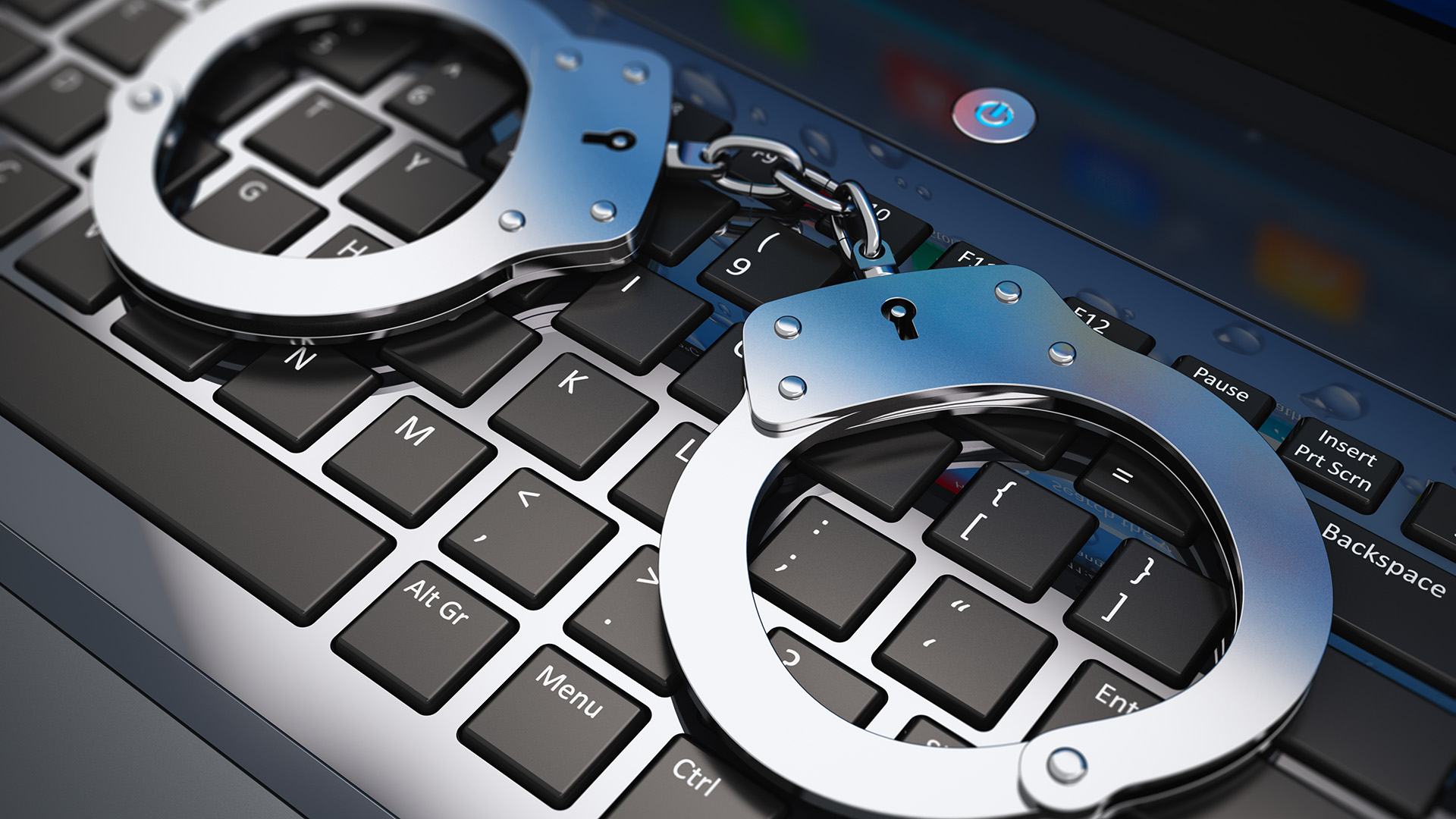 handcuffs-computer-cyber-keyboard-arrested