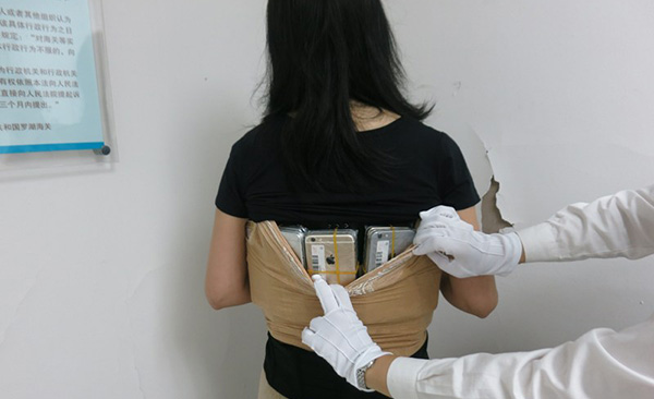 Woman Caught Smuggling 102 iPhone Units Into China by Wearing Them
